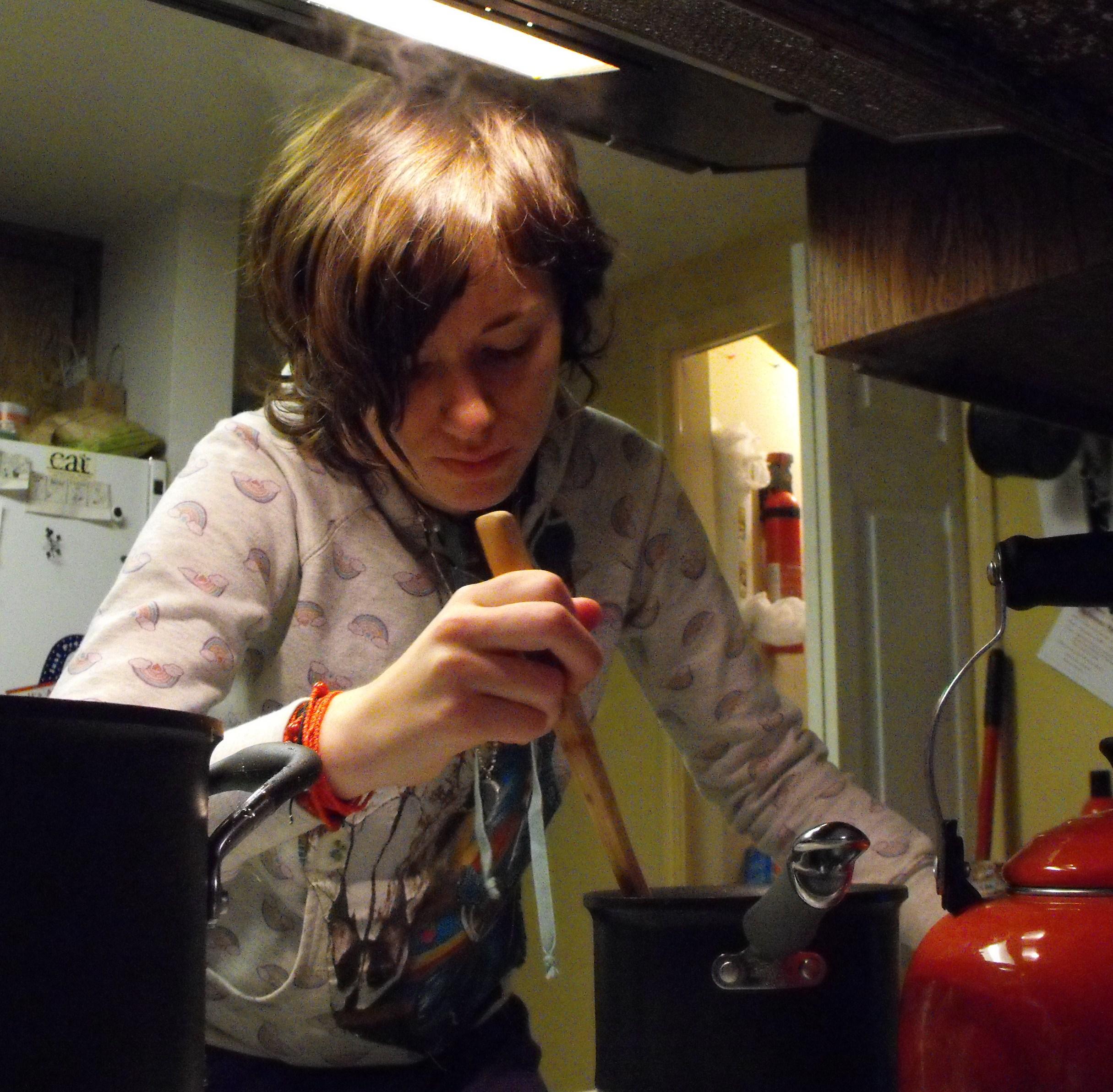 Miranda making sauce